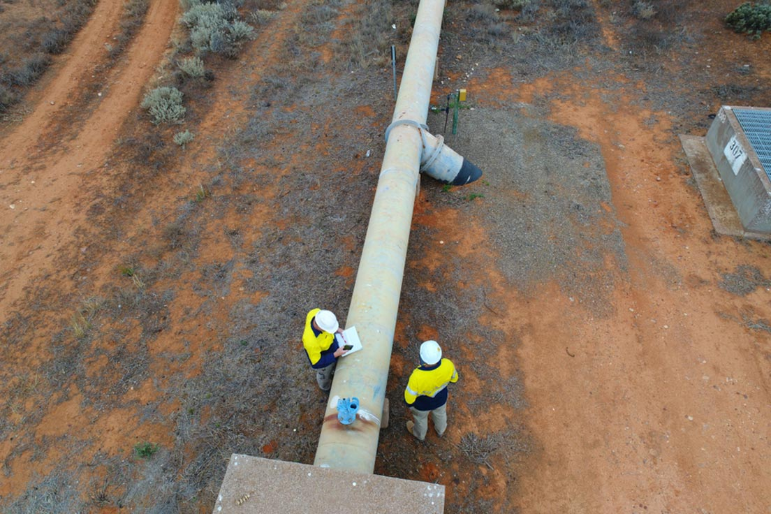 Crew inspecting a pipeline