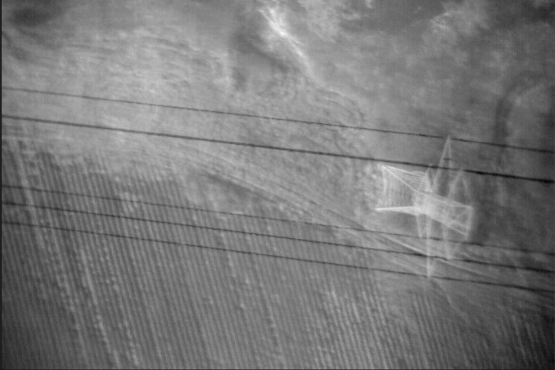 A thermal image of a power transmission line from an infrared sensor
