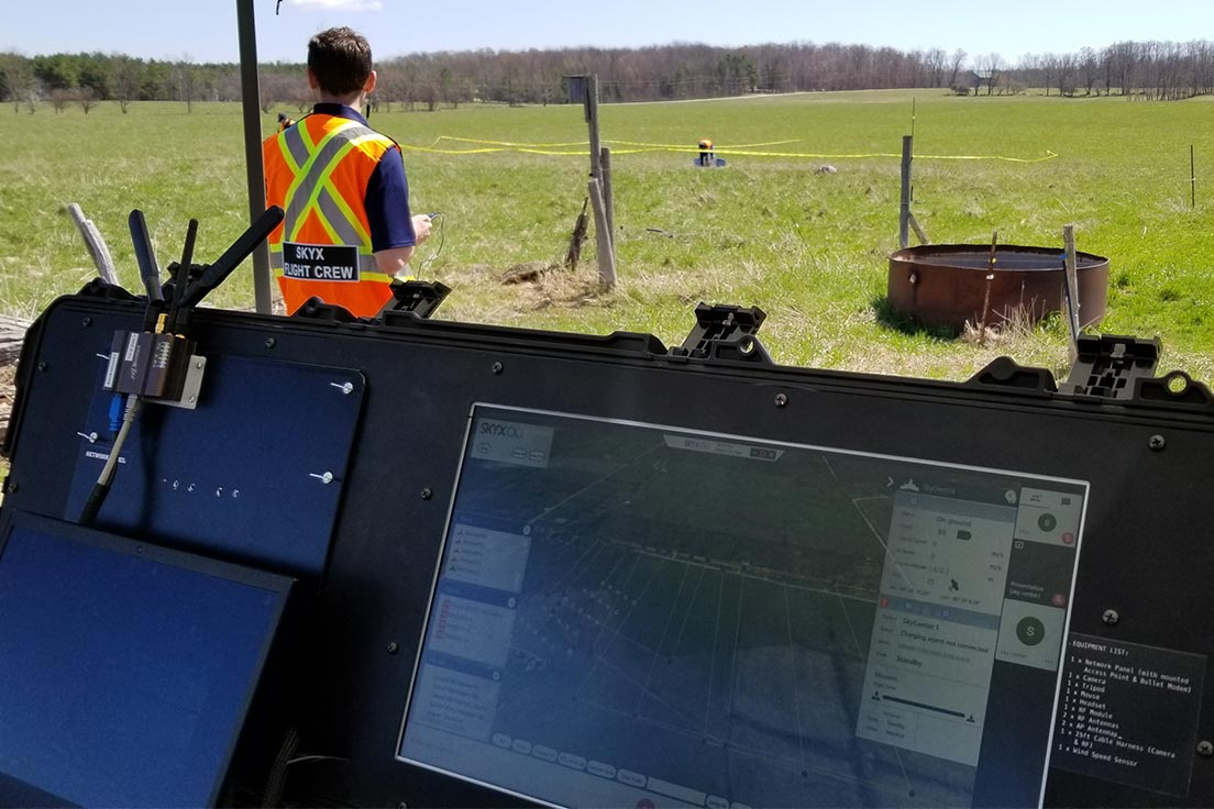 SkyX team members perform a search and rescue operation with a UAV in the field